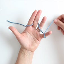 wrap a line of yarn around your fingers