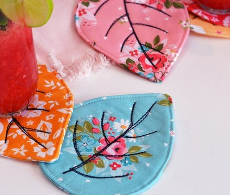 leaf shaped sewn coasters made from floral fat quarter fabric