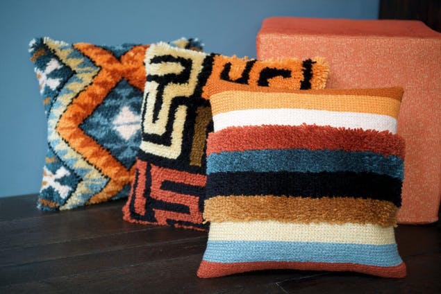 3 latch hook cushions with different colourful patterns