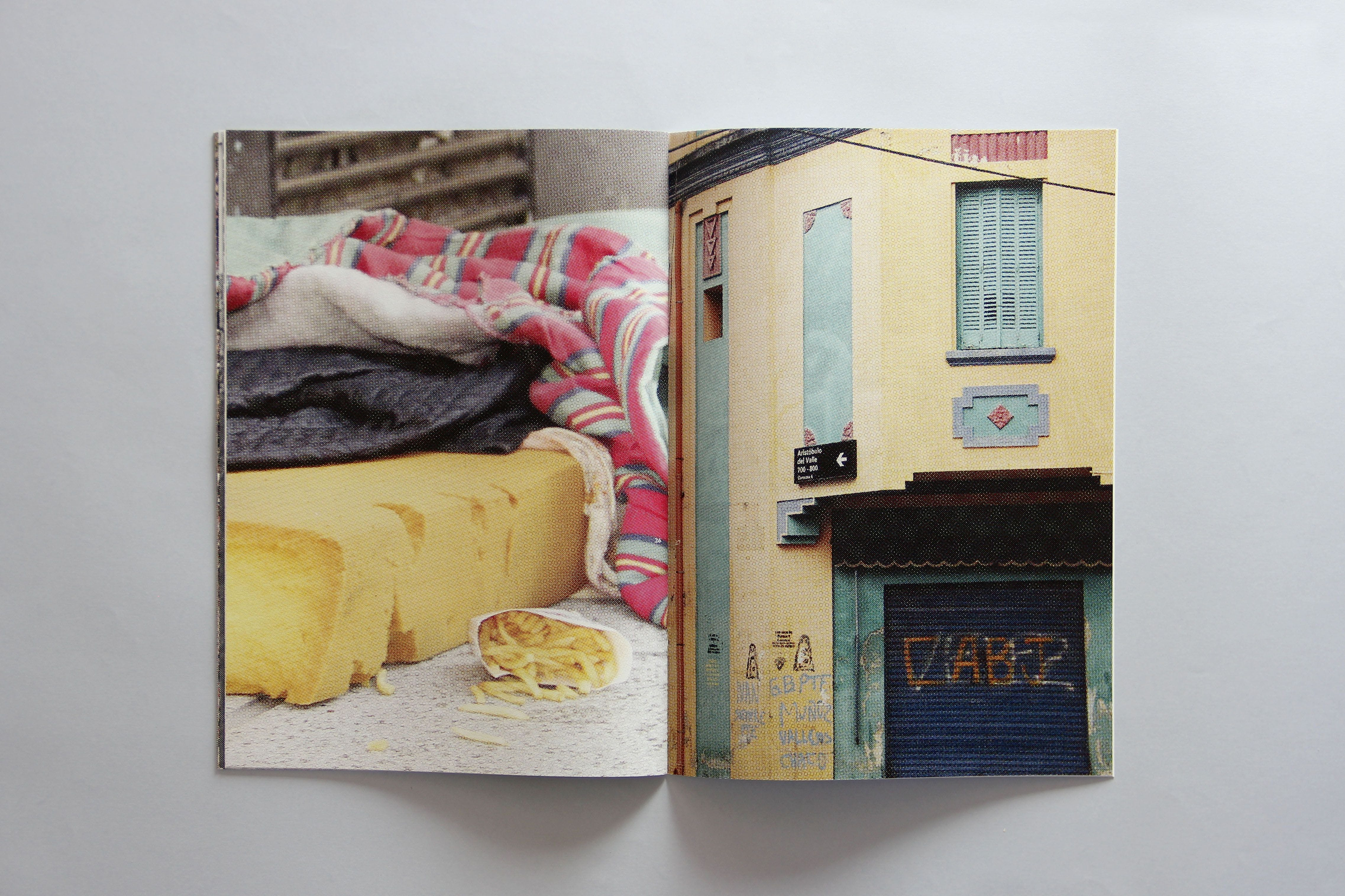 left page depicting some old bedding, right page depicting a store front in Argentina