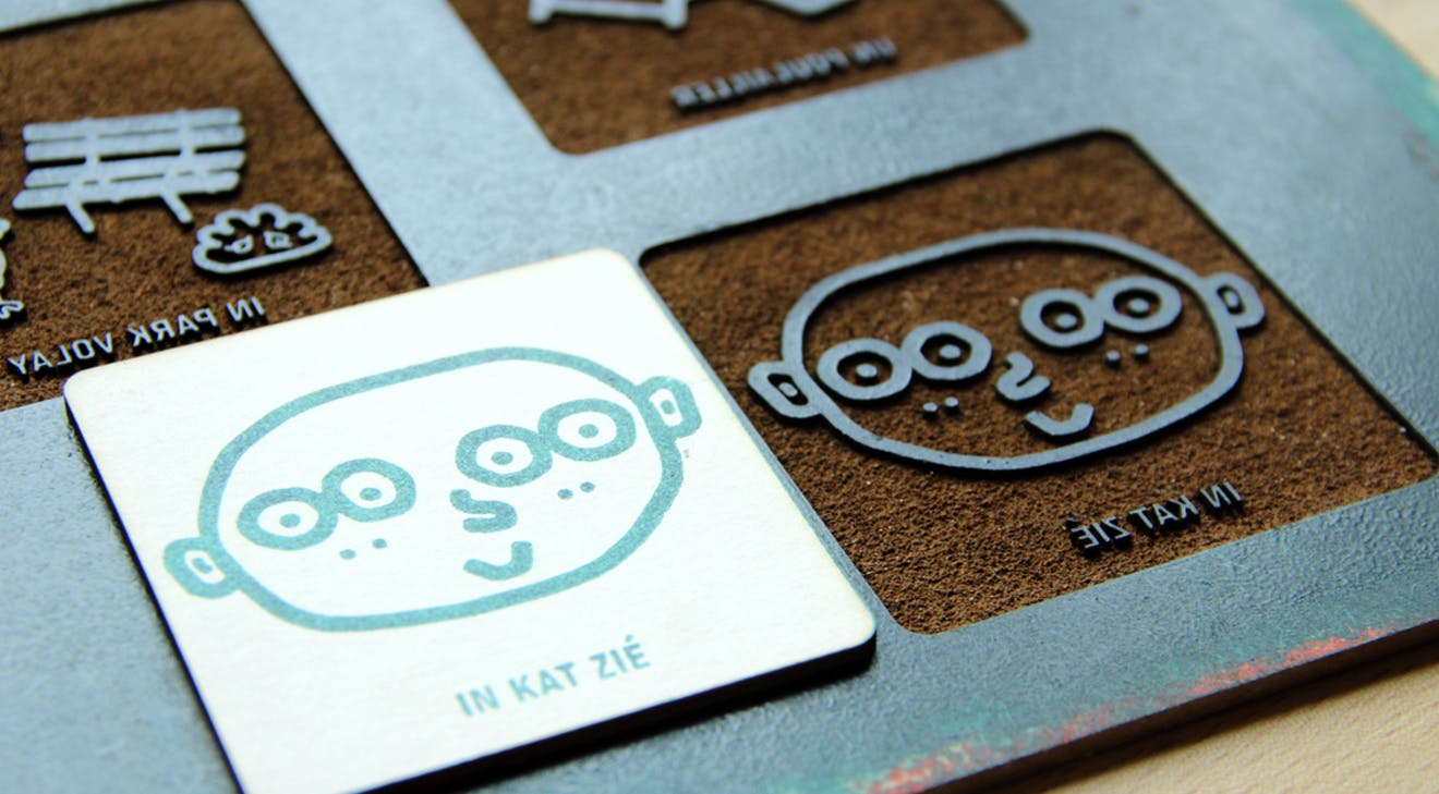 finshed product of laser cut pads and cards etched with a printing press