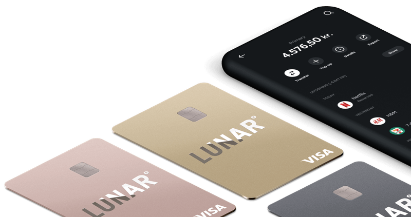 Payment card in different colors next to a mobile bank