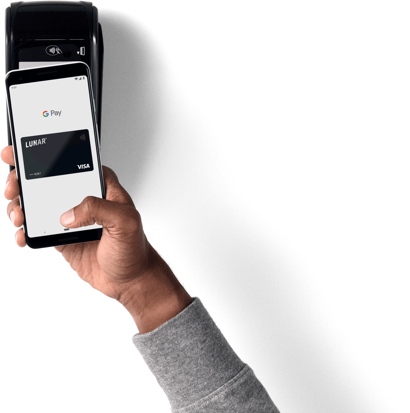 Paying with Google Pay by holding mobile phone over a payment terminal