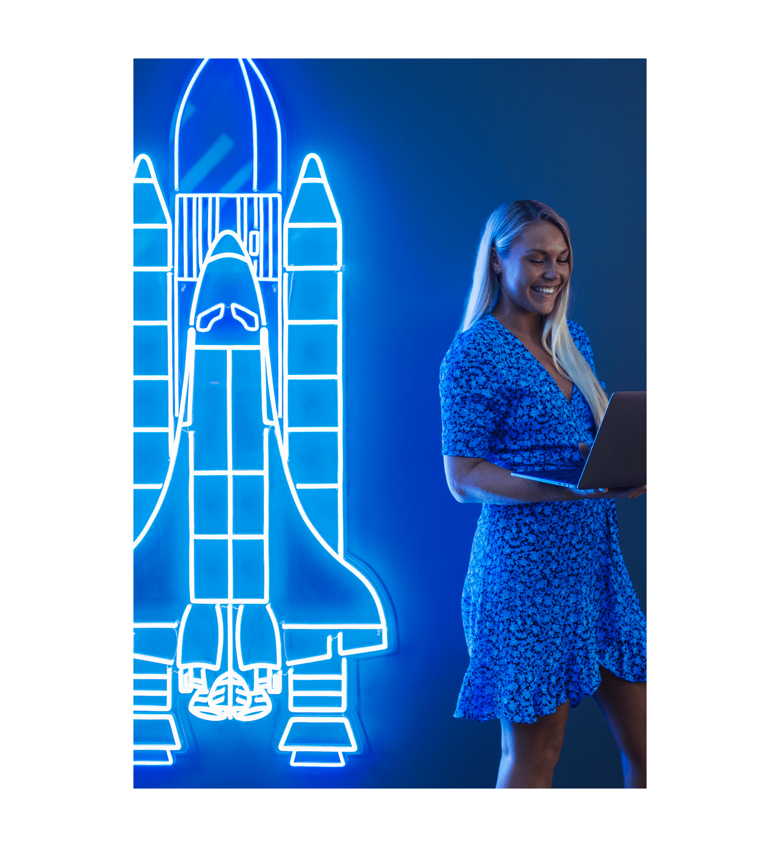 Lunar employee and spaceship in neon