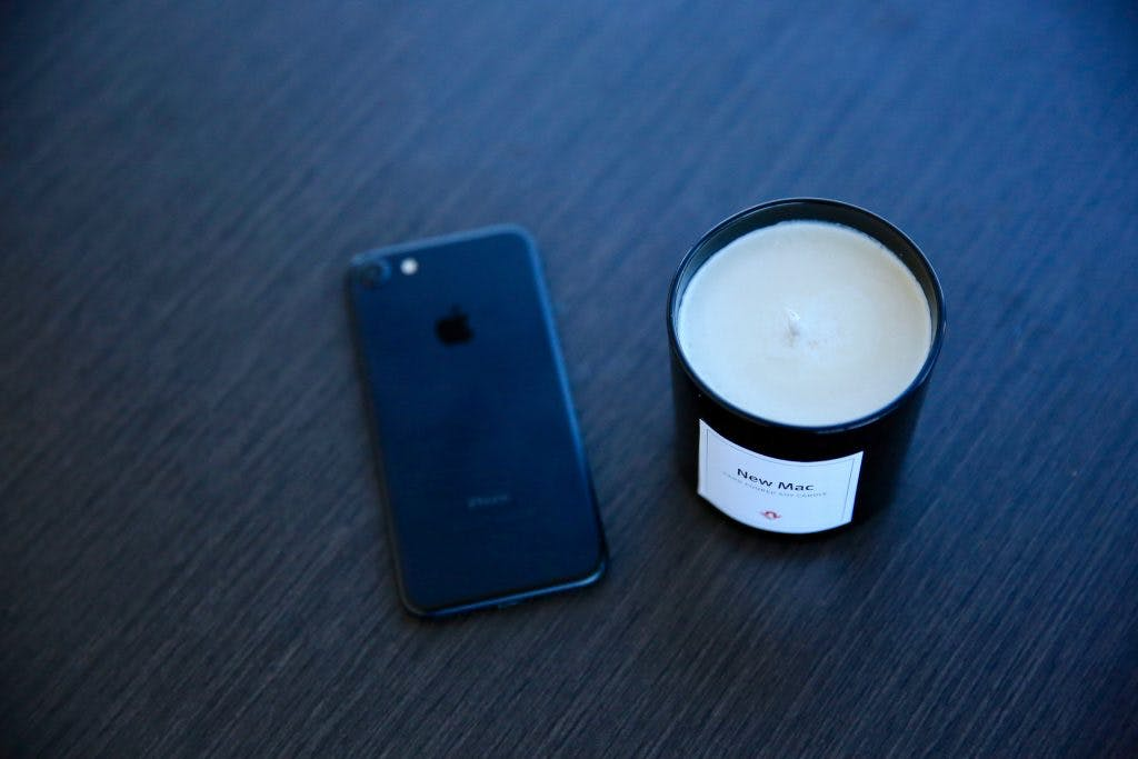Candle and iPhone
