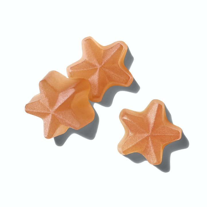 Close up image of Such Good Skin star shaped pink chewable gummies.