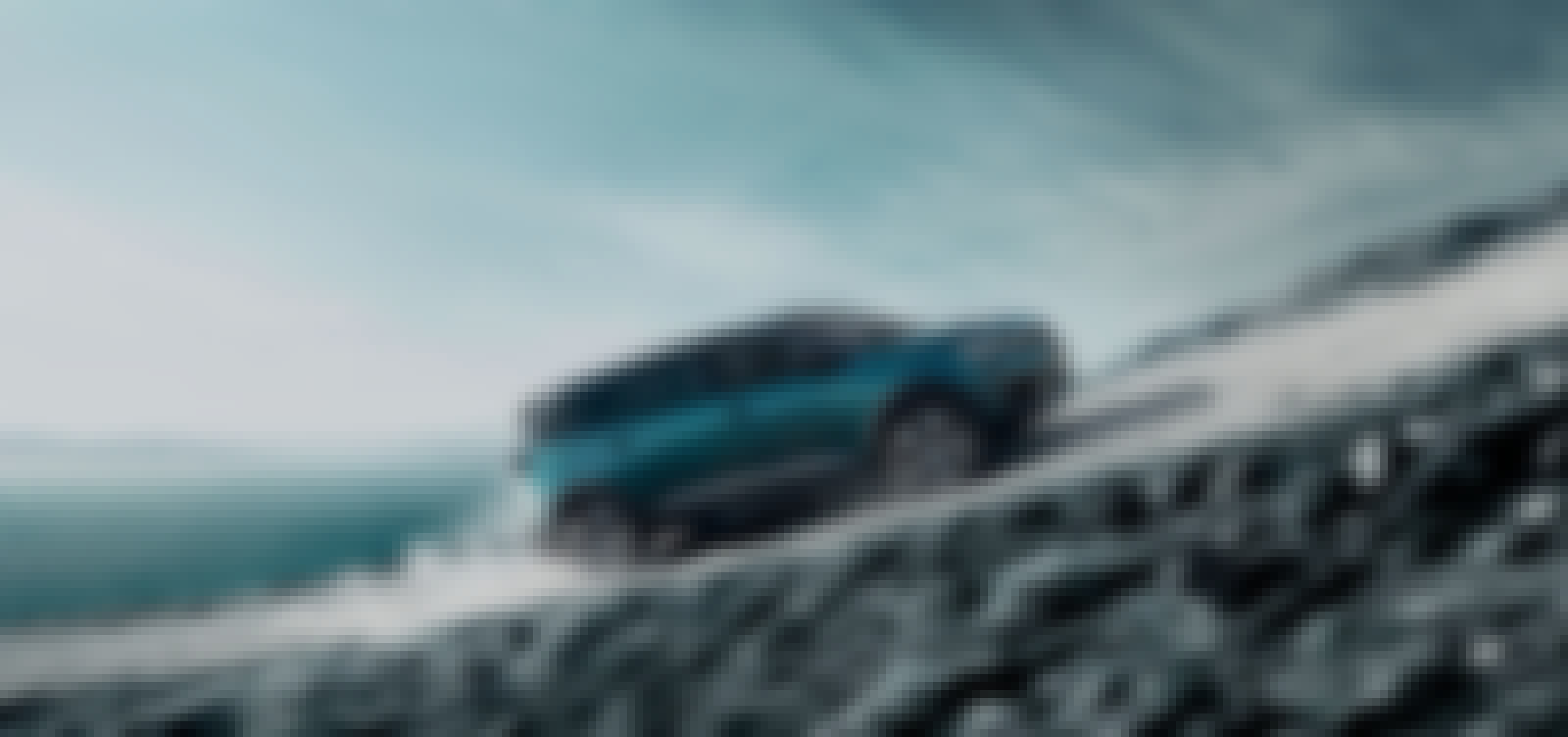 Blue peugeot 3008 driving on a steep slope