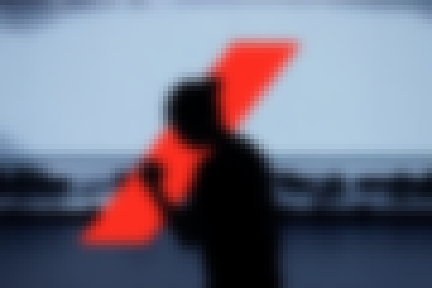 Silhouette of a women in front of the Axa red bar