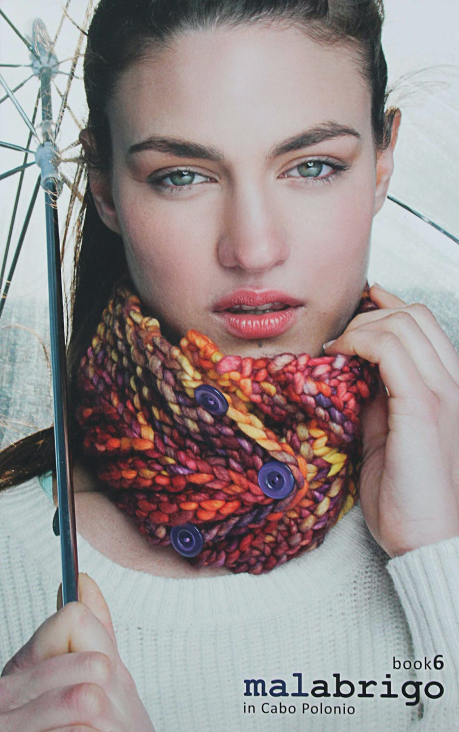 malabrigo book 6 cover. Girl with an umbrella and a knitted cowl