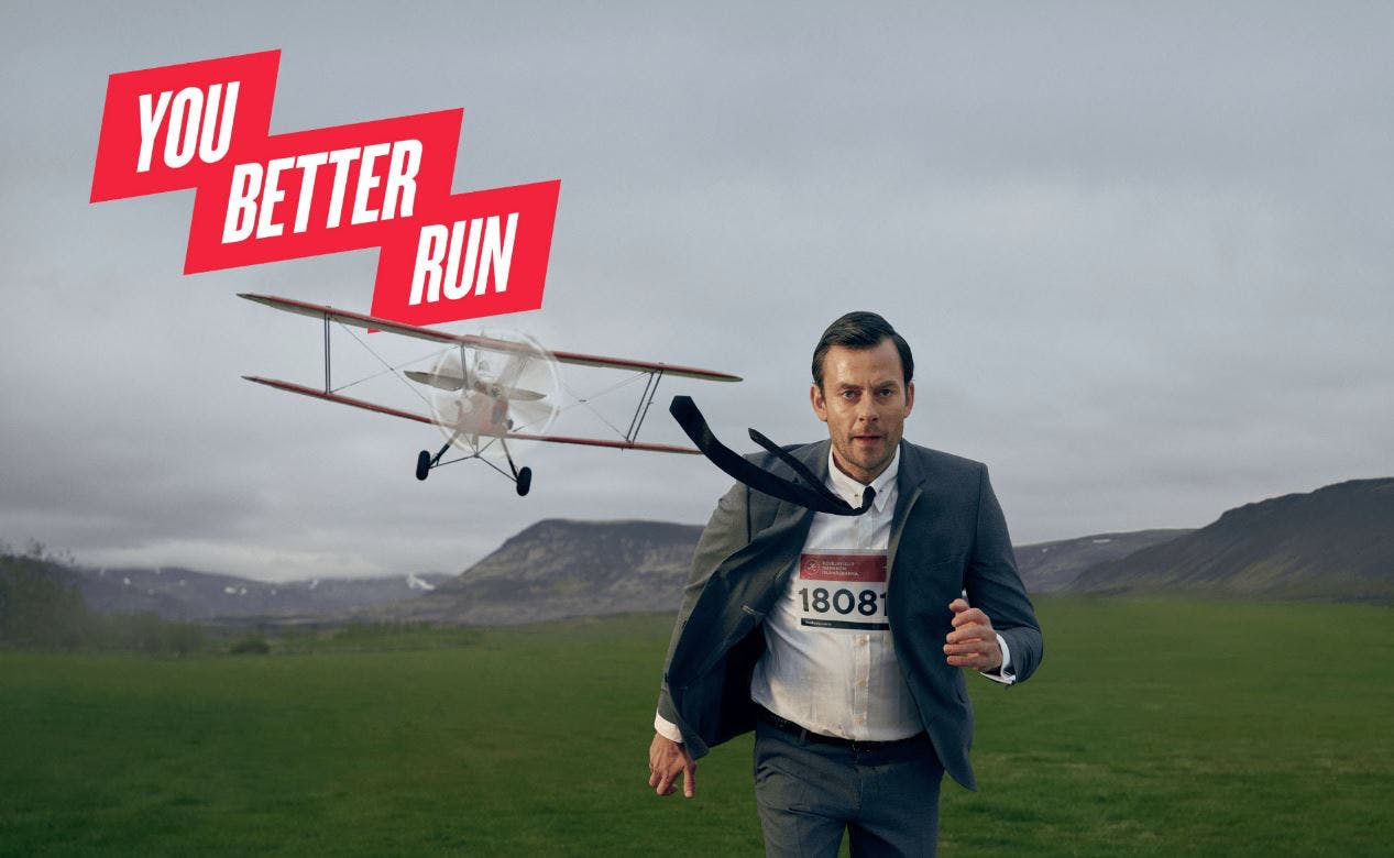 A man running with an airplane behind him and the logo you better run.