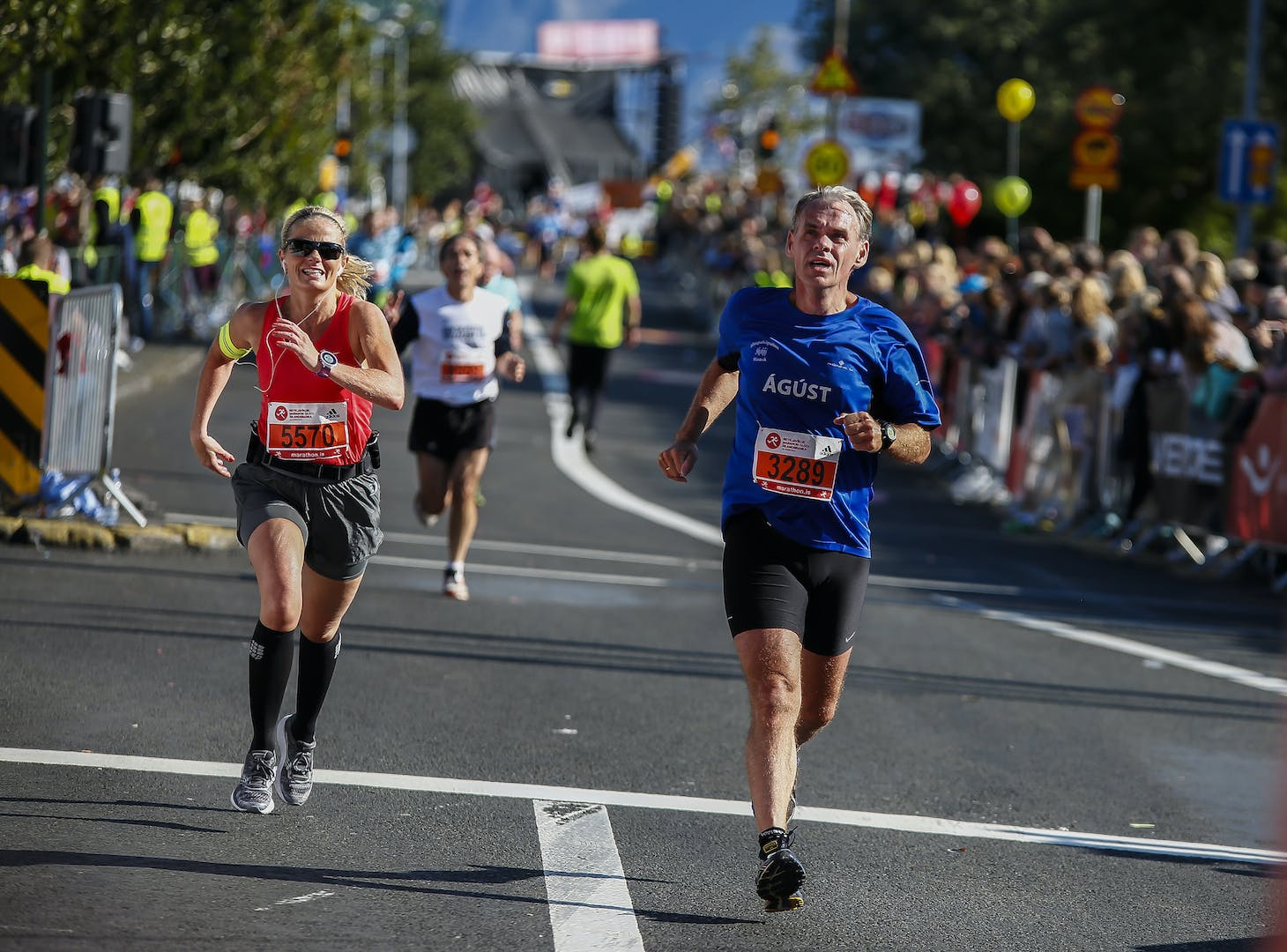 Participants finishing the race in street Lækjargata
