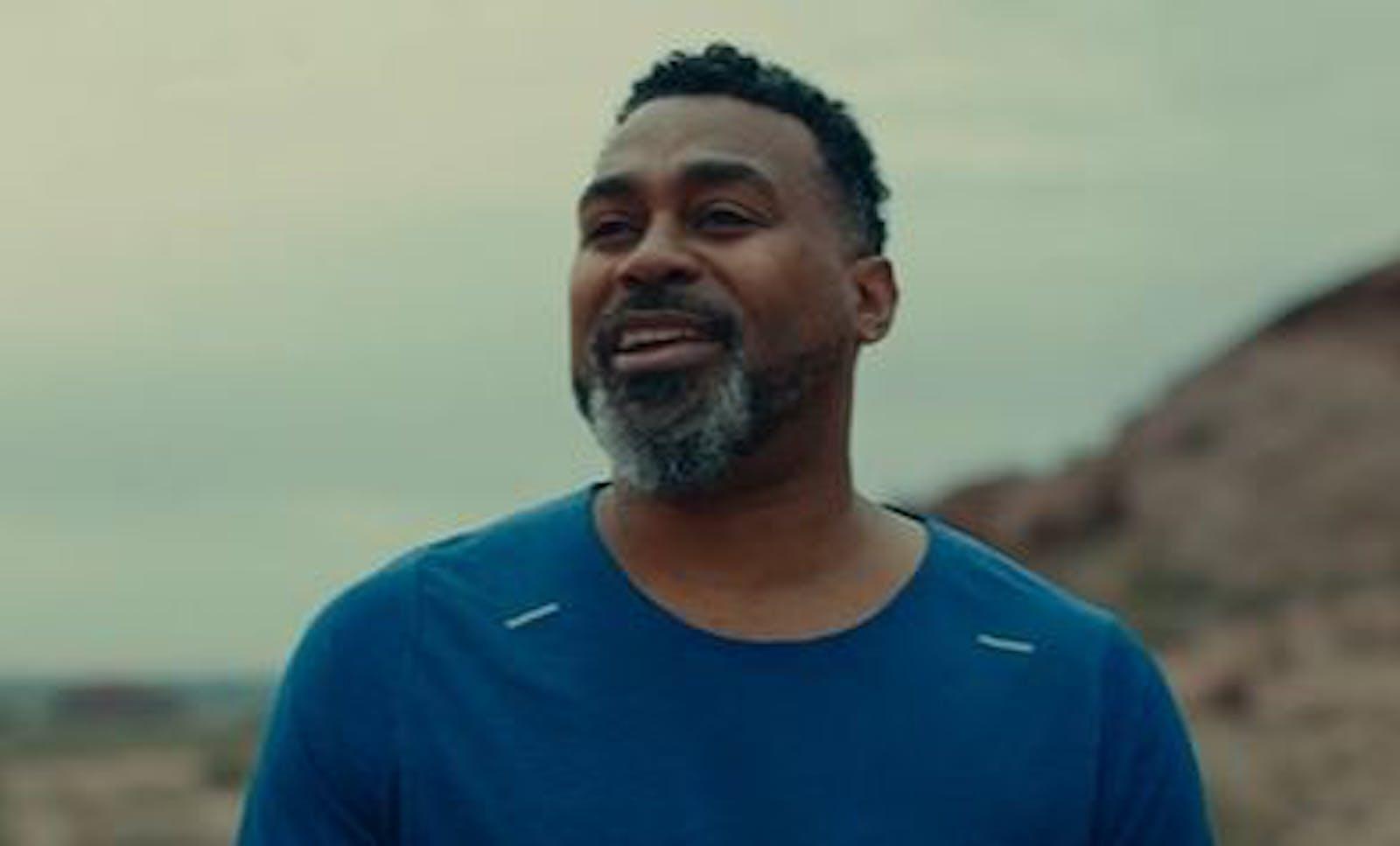 Man in blue t-shirt smiling