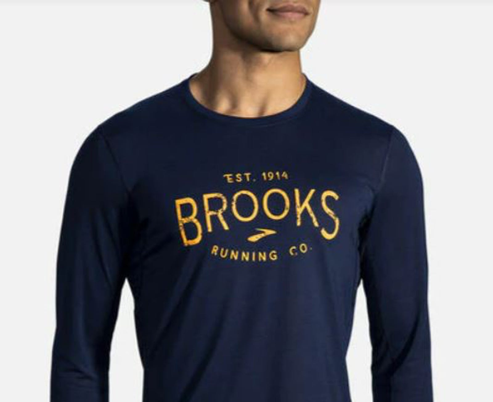 Man in long-sleeved Brooks shirt