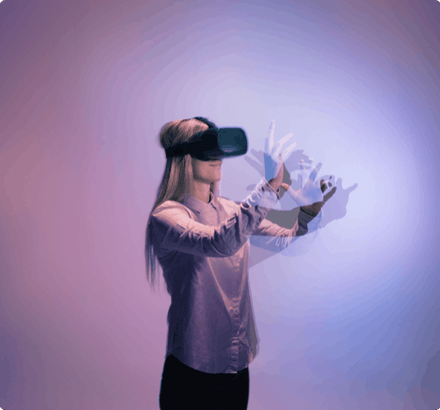 Surreal image of woman in VR headset moving her arms in a motion blur against a purple vignette background