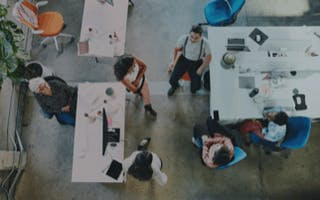 Overhead view of creative technology team brainstorming their next big product