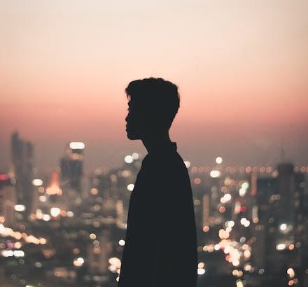 Man staring at sunset