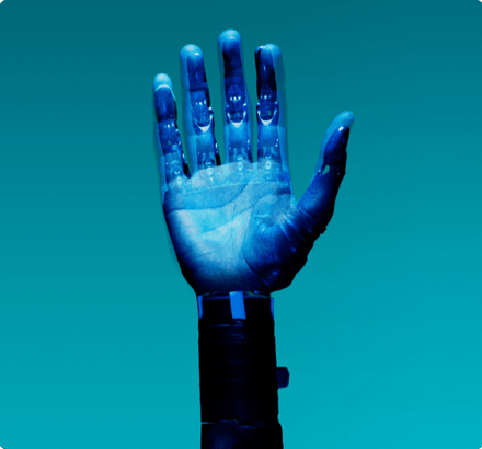 A robotic hand is overplayed on a turquoise screen