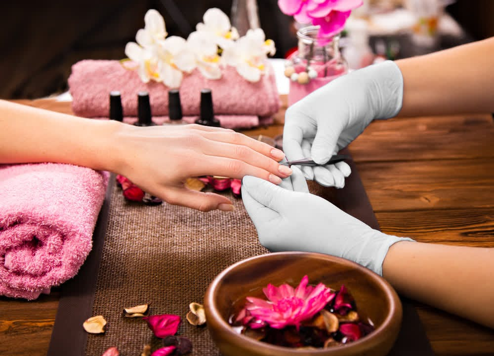 woman getting nails curated