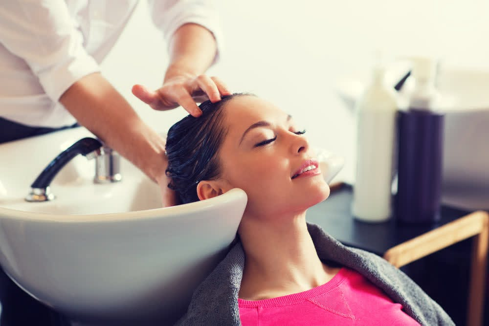 woman getting hair washed