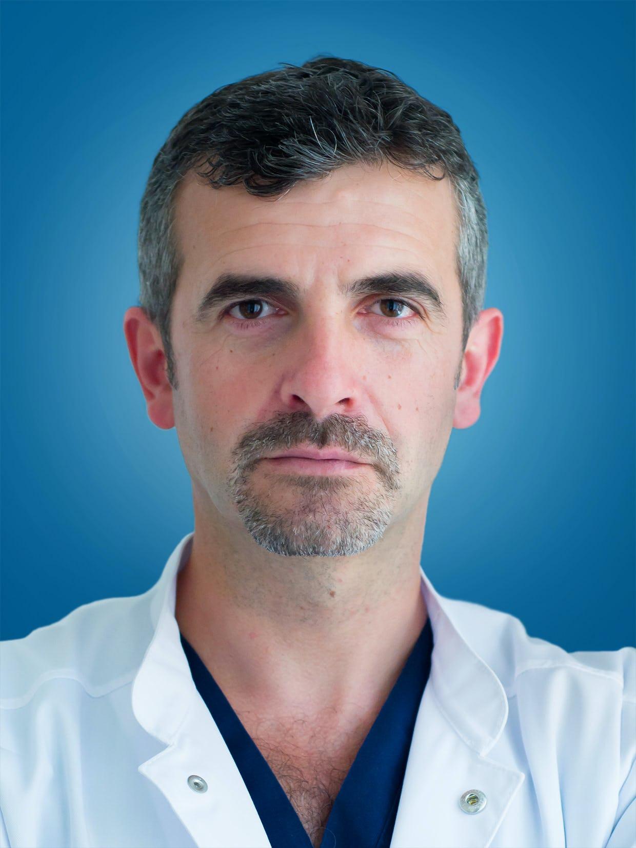 Dr. Adrian Pavel