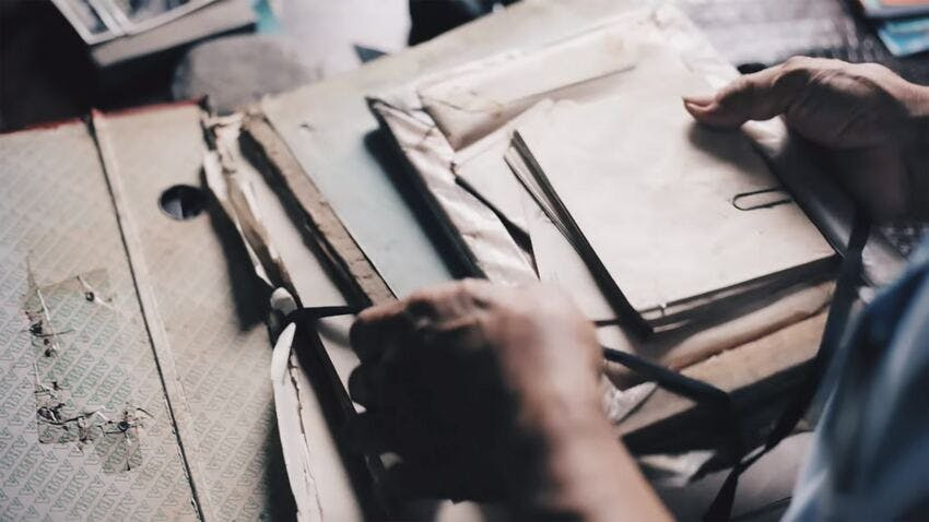 hands-papers-brown