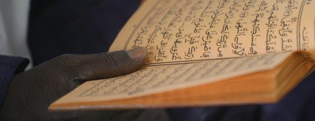 main tenant le Coran