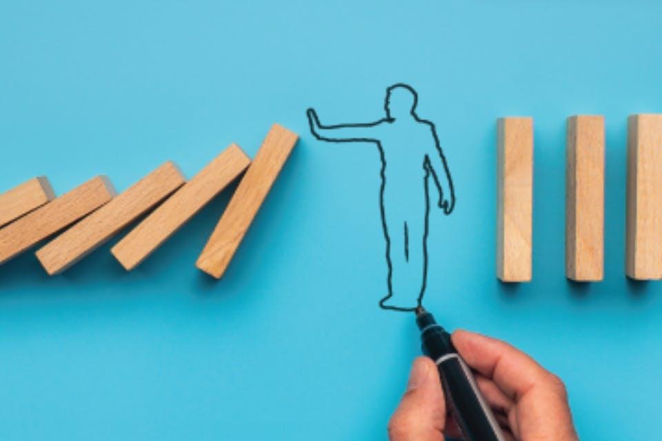 illustration of man holding up falling planks