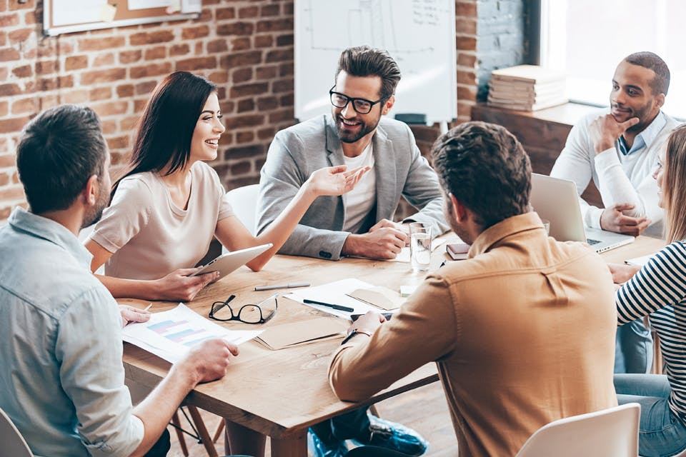 People sitting around a table in a meeting