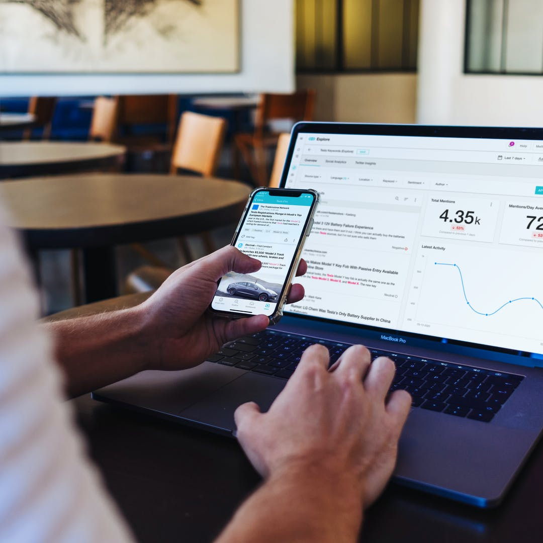 Laptop and Smartphone with Meltwater Explore for social listening, media monitoring and media analysis