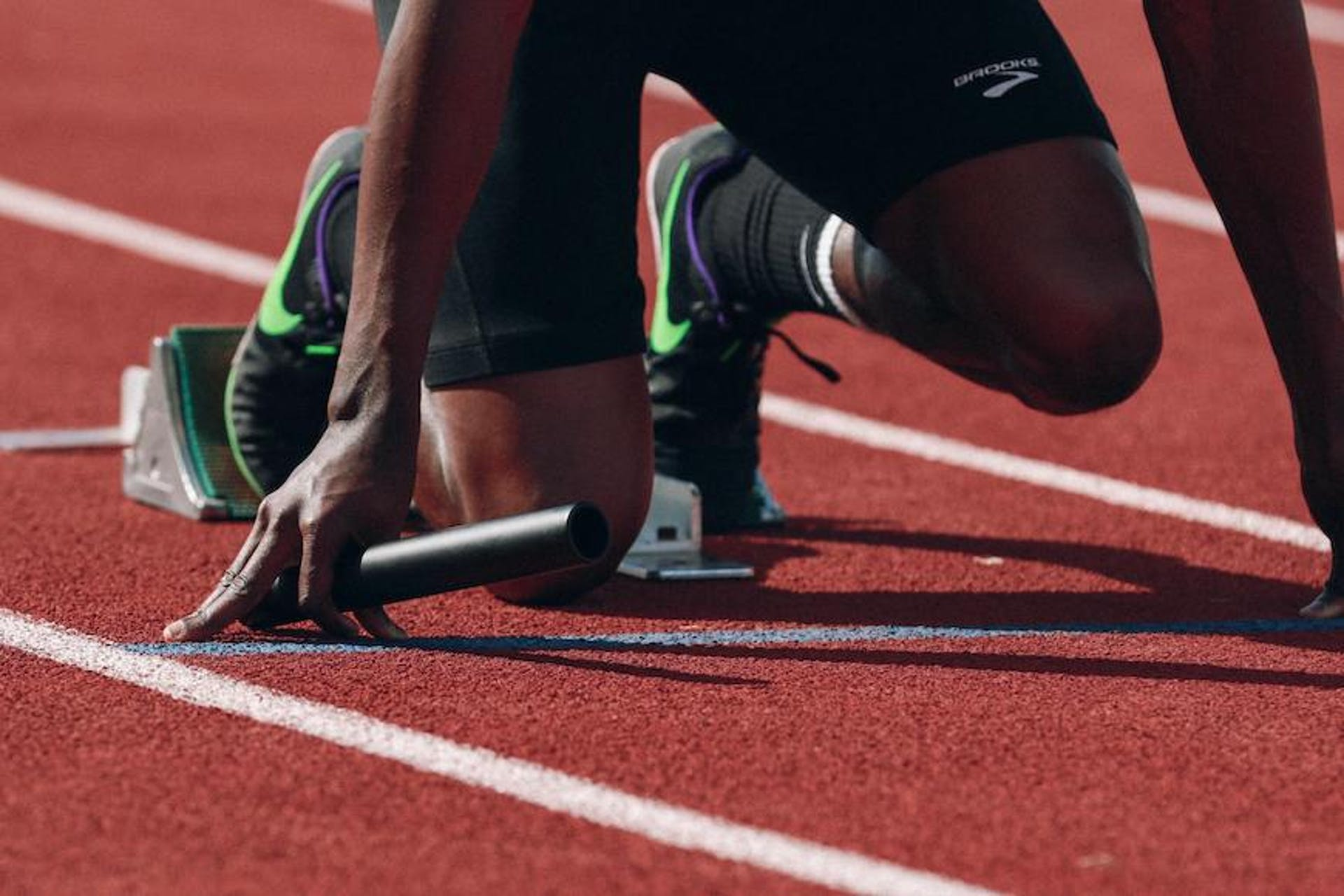Photo of a runner on the track