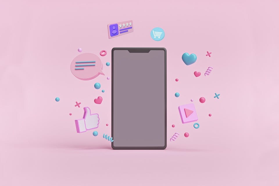 An illustrated version of a smartphone with confetti and social media iconography, like a heart and a Facebook like button, floating around the phone. These celebratory symbols and icons represent the engagement notifications a community manager would hope to see after implementing a new social media marketing strategy.