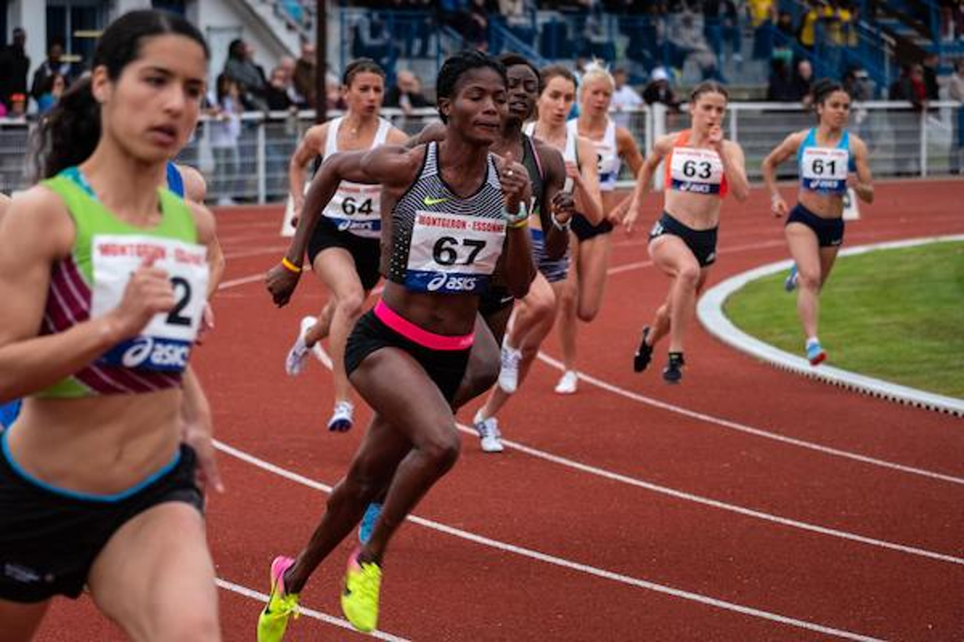 photo of a race of runners in the stadium