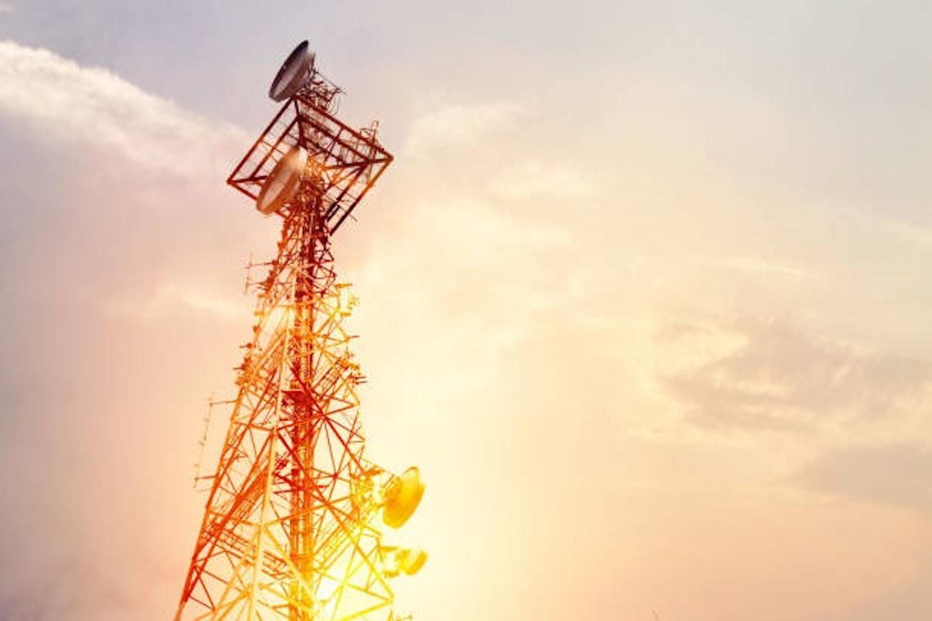 telecom tower with an orange sky
