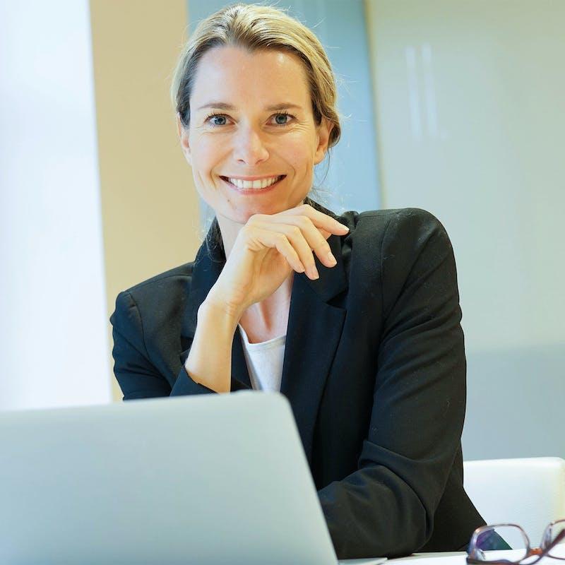 woman sitting behind her laptop