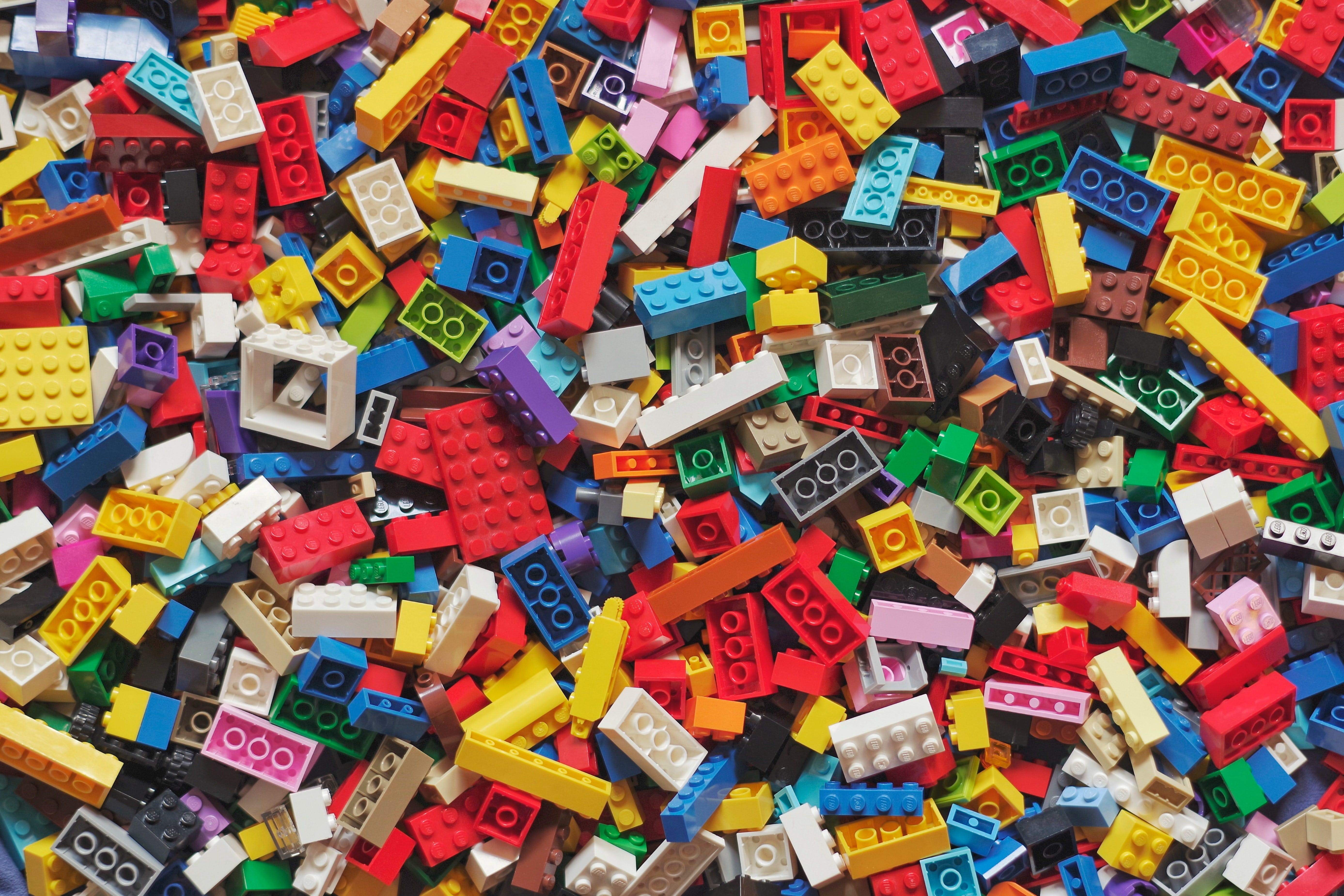 Building a social media strategy for 2021. Image of large pile of multi-colored lego bricks