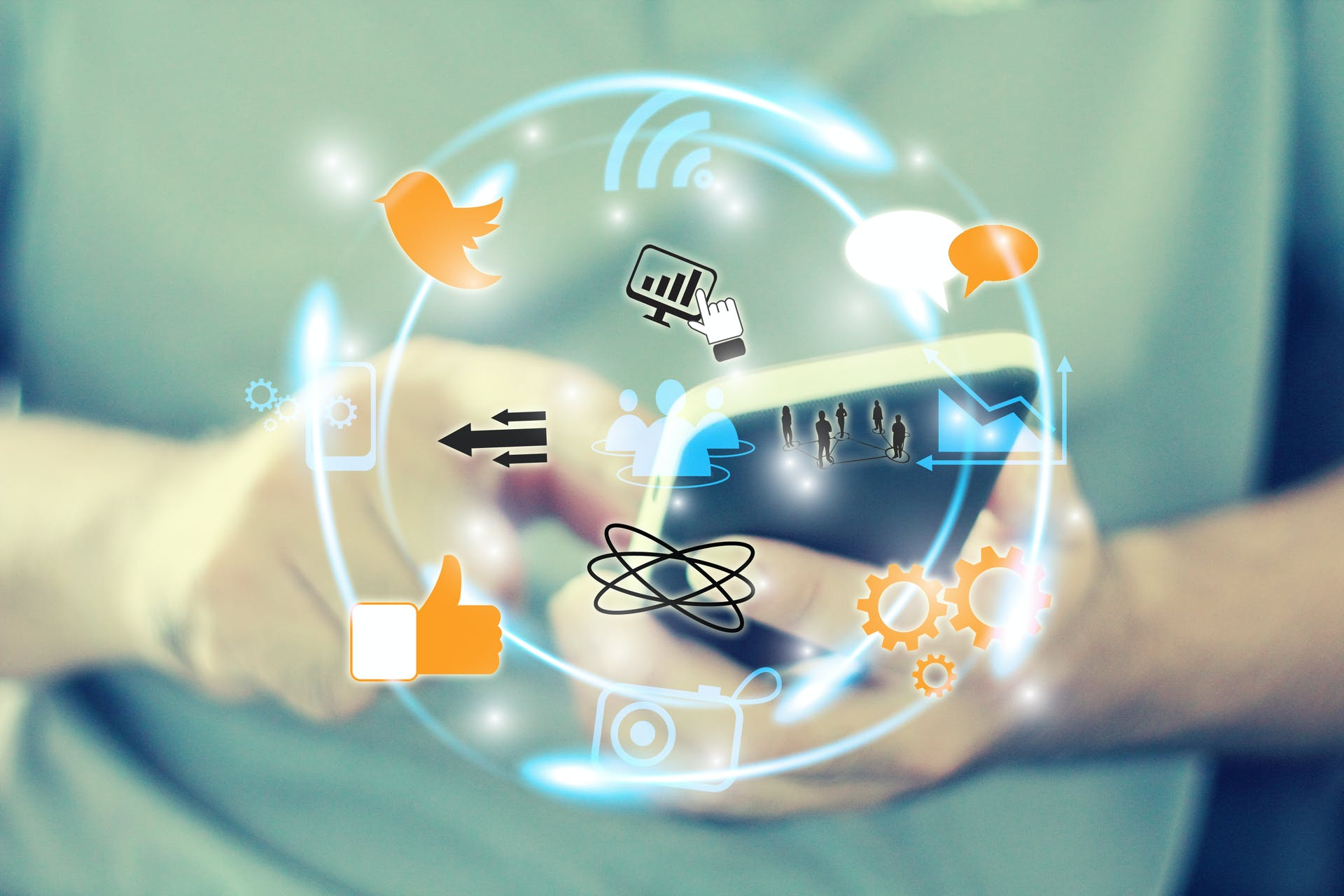 Illustration of social and technological icons against an image of a man using his smartphone