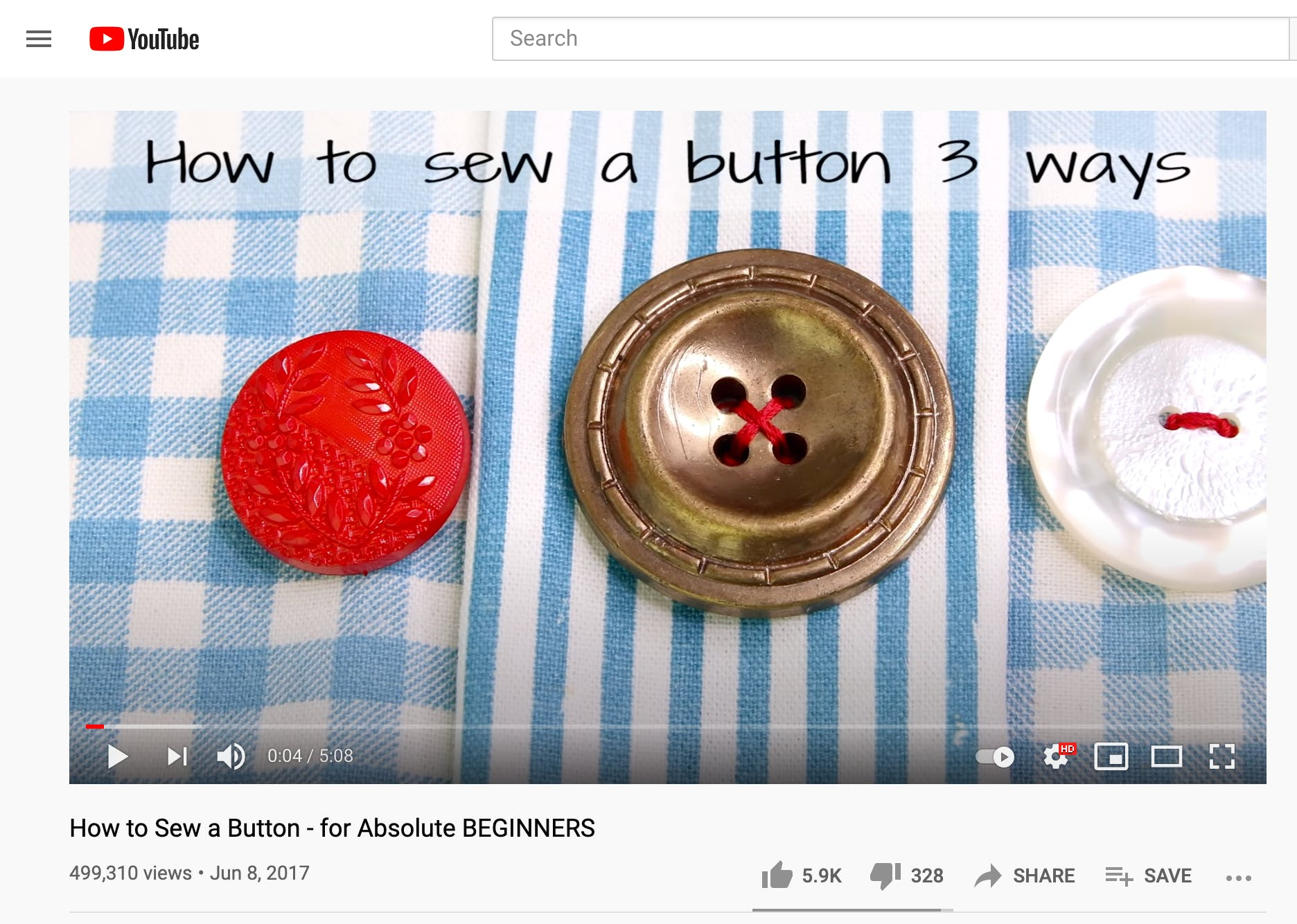 Screenshot of YouTube video about how to sew a button