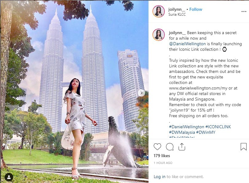 Picture of woman posing in front of buildings
