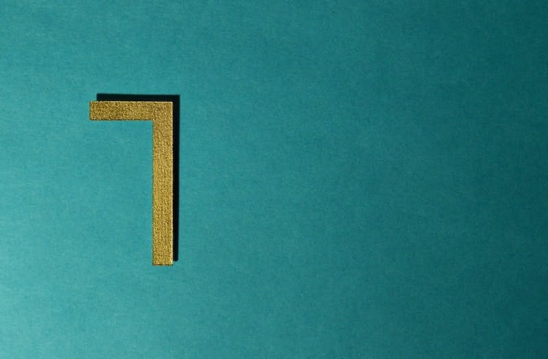 The number seven is displayed on a turquoise background