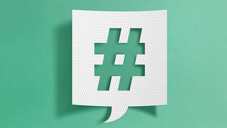 Hashtag symbol on green background. Implement hashtag search for your Instagram marketing