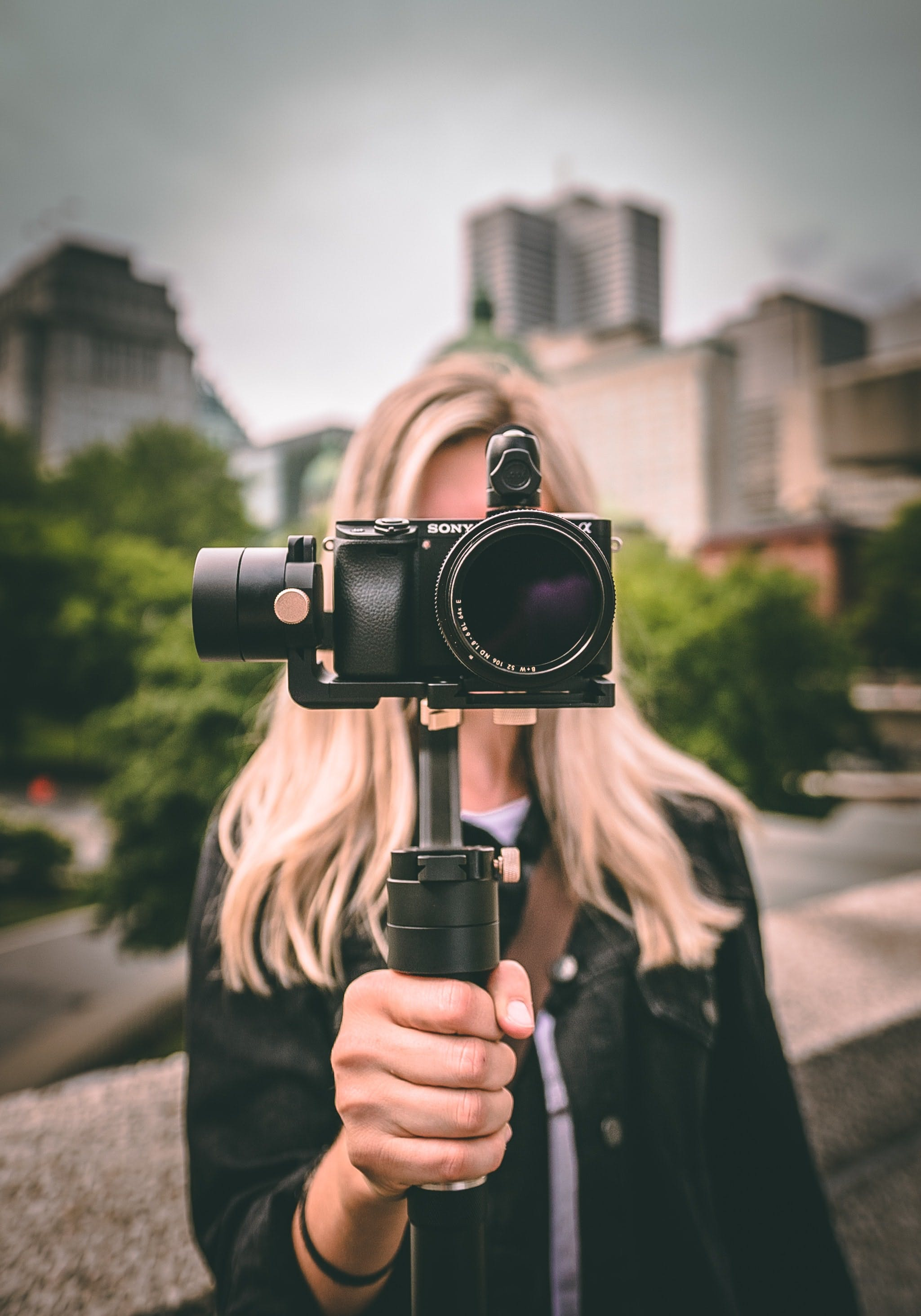 Young woman holding a small video camera
