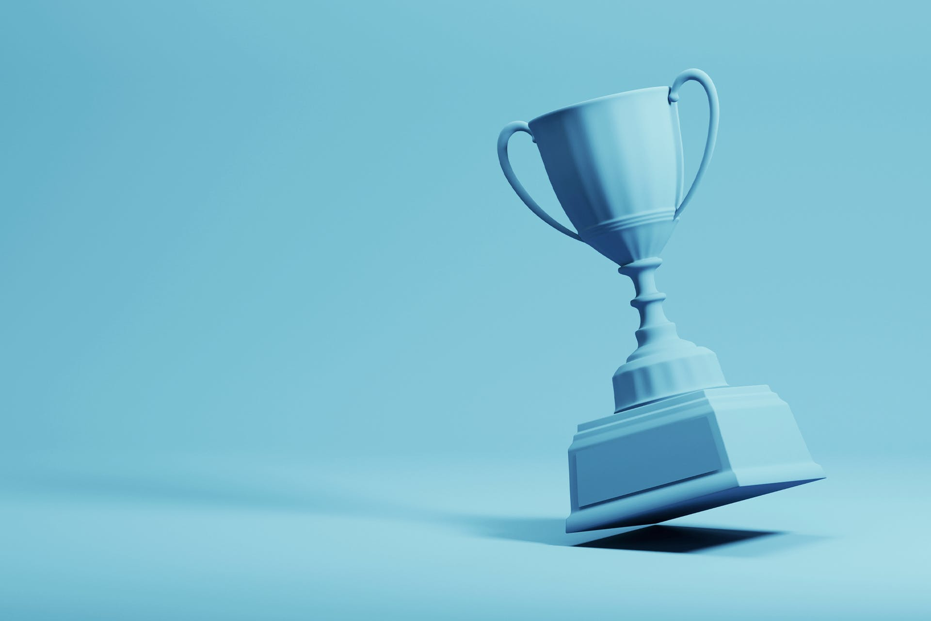 A blue trophy, like the one you might win if Facebook or Twitter gave out an award for the best social media marketing campaign, is set against a blue background.
