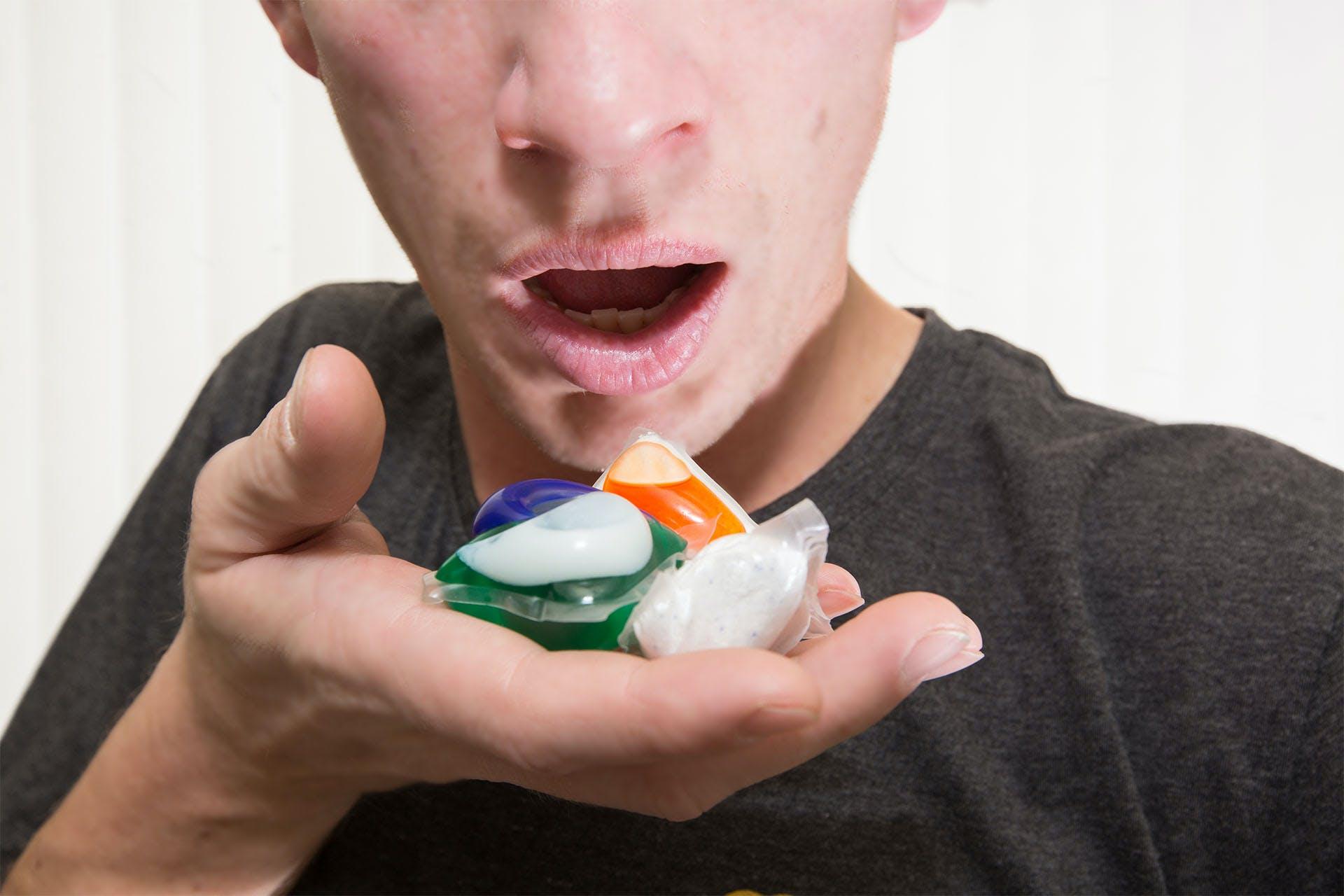 person holding detergent pods for the tide pod social media challenge