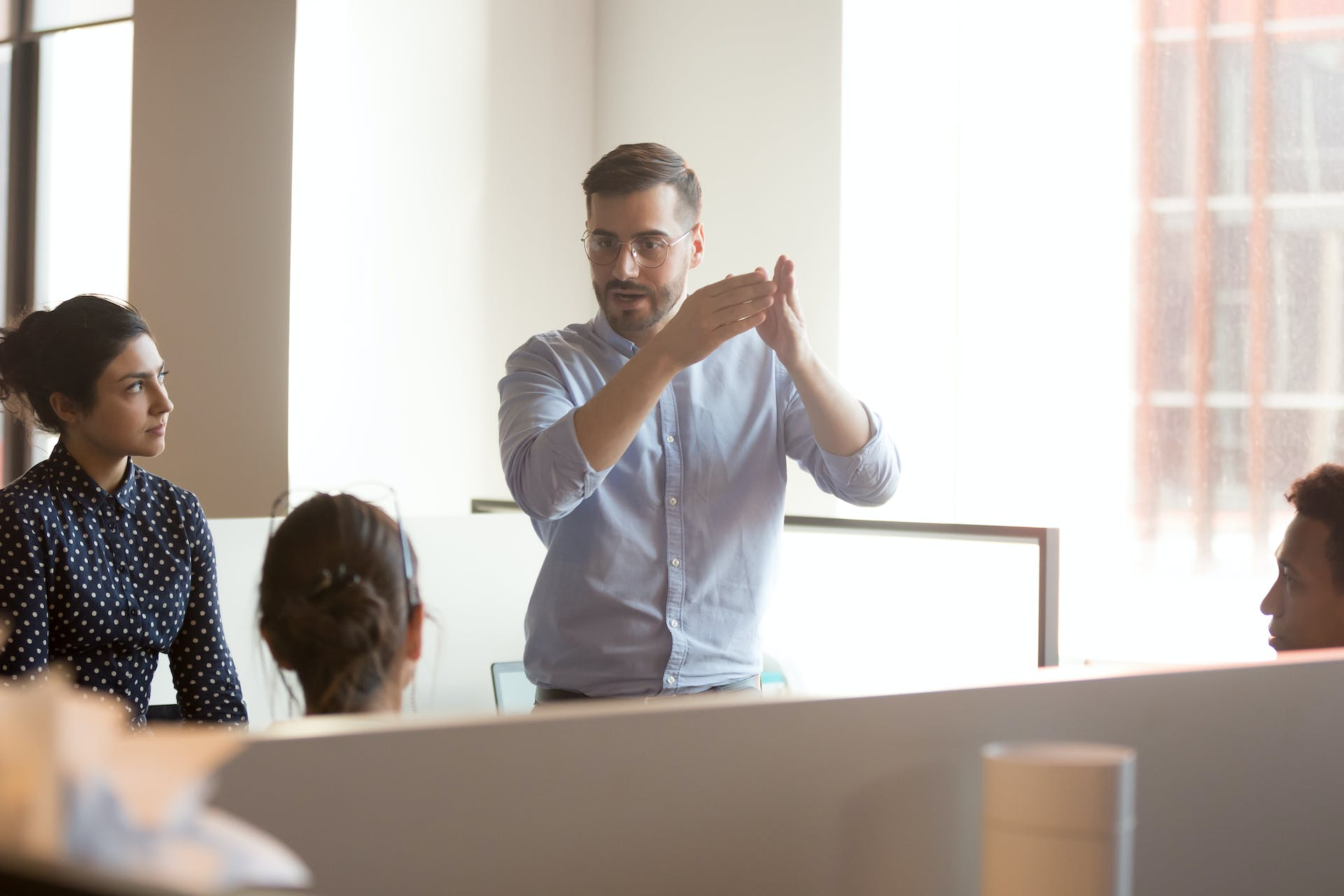 A team leader demonstrating a concept to his team using gestures