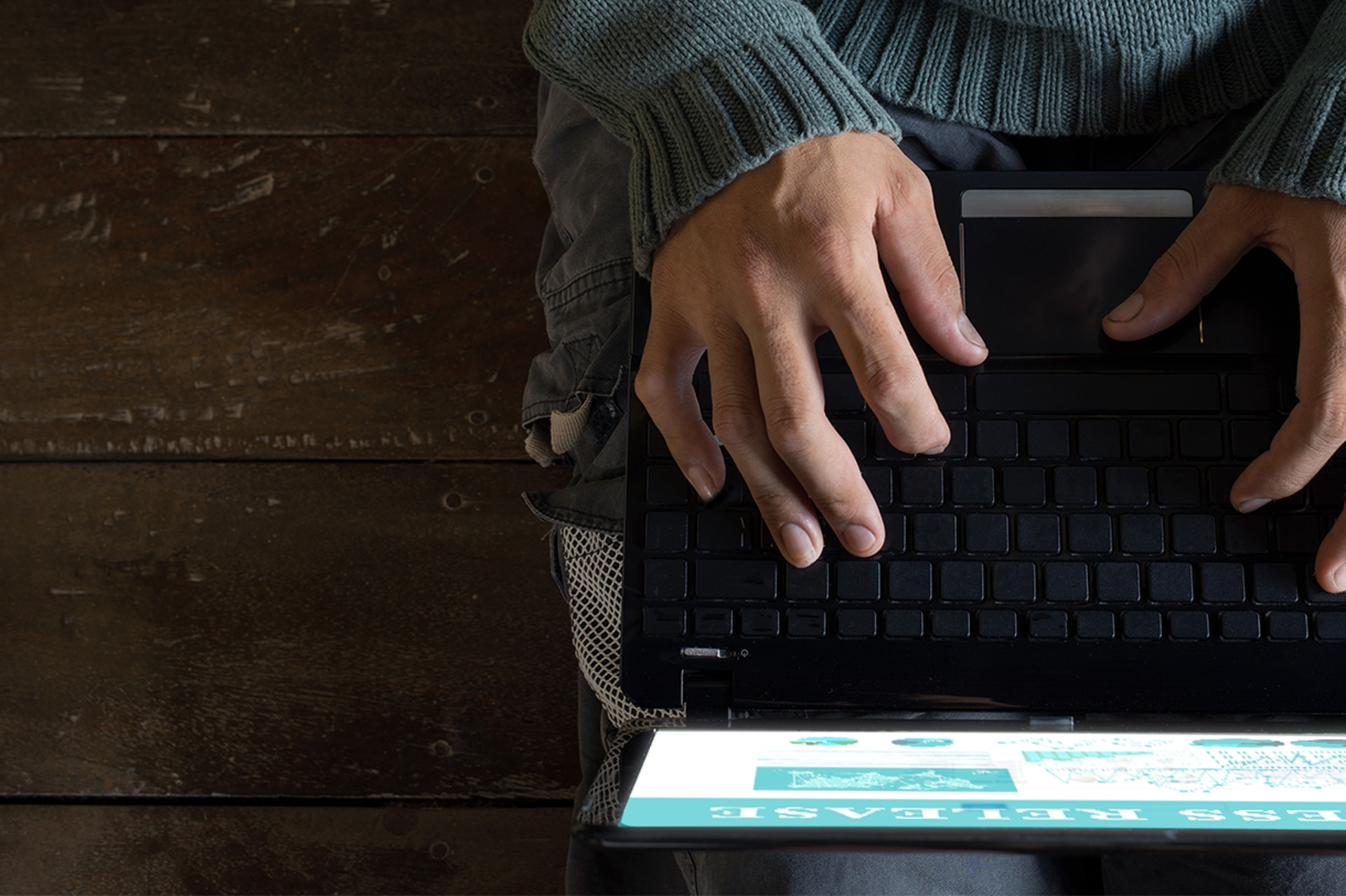 hands typing on a laptop screen