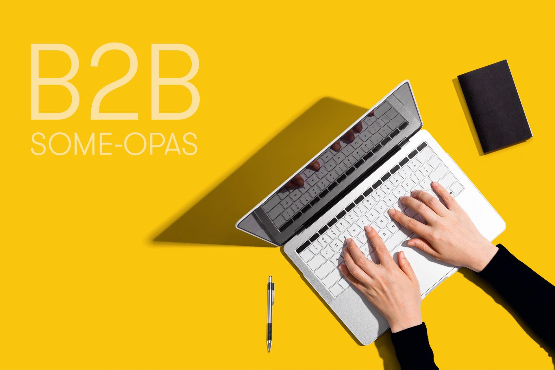B2B some-opas, henkilön kädet tietokoneen näppäimistöllä ylhäältä kuvattuna