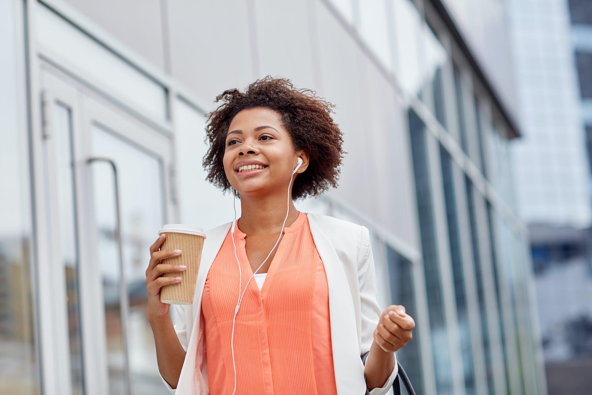 businesswoman listen to podcast