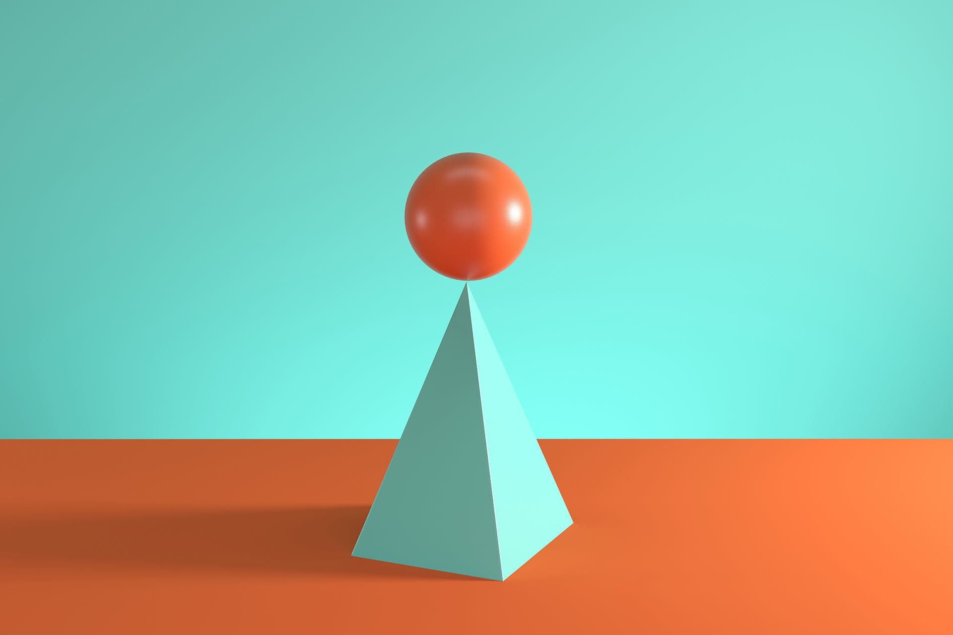 Building a brand strategy framework takes finesse and balance, which is why this image of an orange sphere balanced atop a teal prism is a fitting metaphor for the skill required in assembling a brand strategy.