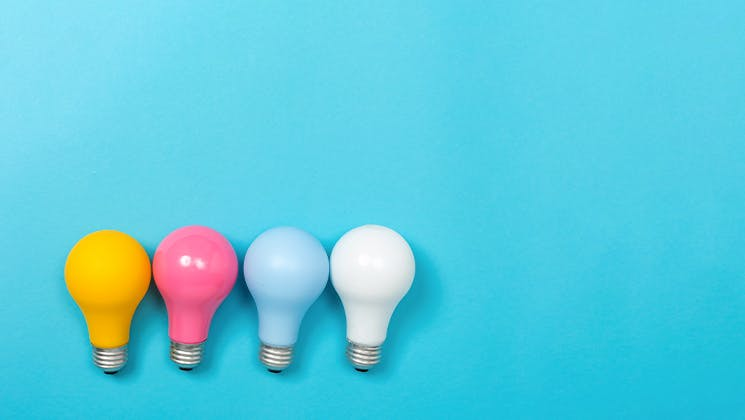 Colourful light bulbs side by side