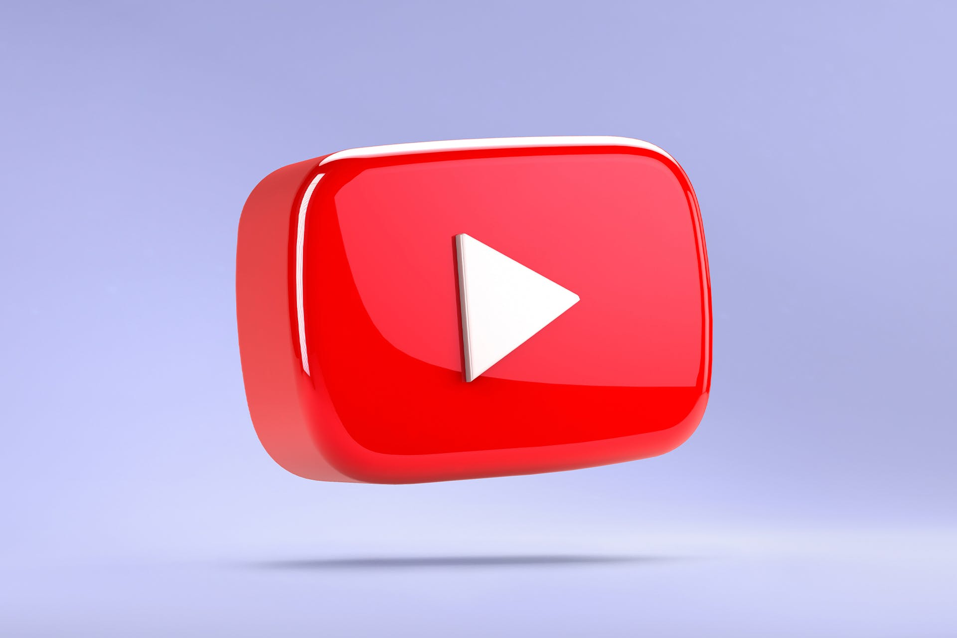 An illustrated image of a video play icon that appears as a red cube with a white triangle in the center. If you are marketing on YouTube, you want your subscribers to be clicking on this video icon player on the platform.